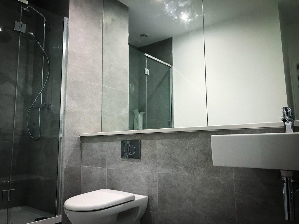 Modern bathroom with grey tiles