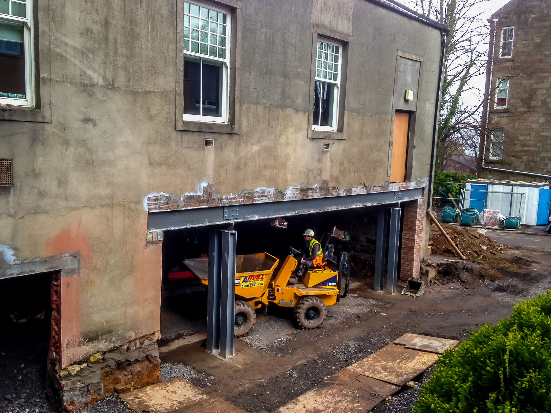 Man on excavator inside building